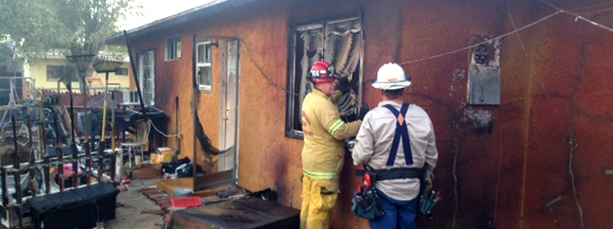 Firefighters inspect burned building