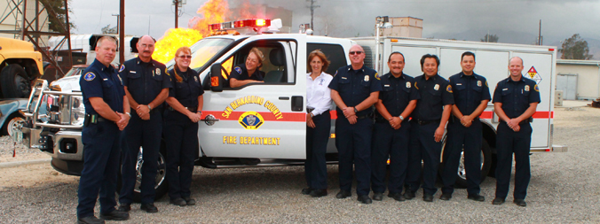 Firefighters in front of emergency vehicle