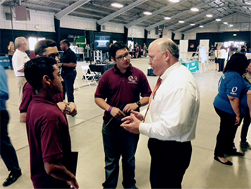 Supervisor Lovingood talking to youth at a manufacturing expo